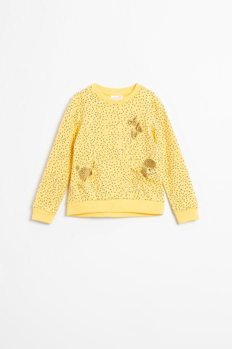 Bluza nierozpinana w kolorze żółtym z ozdobnymi naszywkami